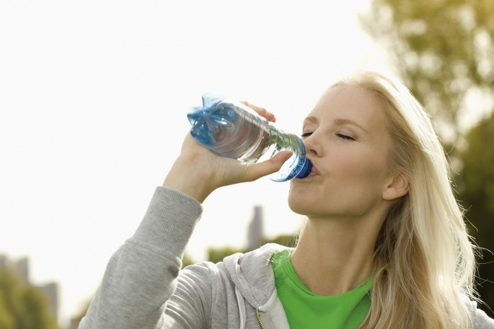w27,blond woman drinking water after sport,duesseldorf,north-rhine-westphalica,germany,europe